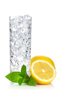 Glass of water with ice, lemon and mint. Isolated on white backg